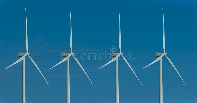 Wind turbines and the morning sky with sunlight royalty free stock image
