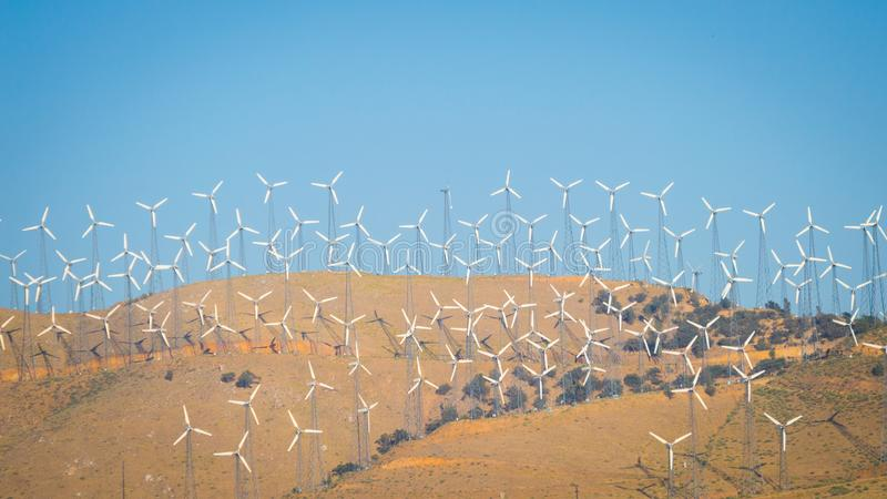 Wind turbines on a mountain. An enormous amount of wind turbines on a mountain stock photos