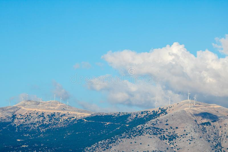 Wind turbines in the mountains of Greek island Kefalonia. Ionian coast in Greece is ideal as a source of renewable energy because of the strong northwest wind royalty free stock images