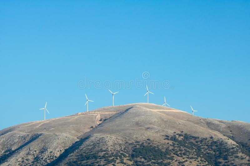 Wind turbines in the mountains of Greek island Kefalonia. Ionian coast in Greece is ideal as a source of renewable energy because of the strong northwest wind royalty free stock photos