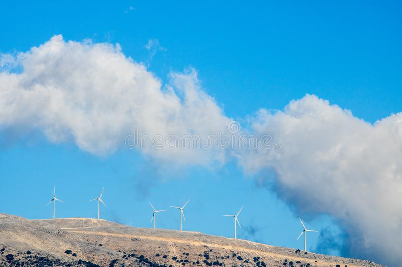 Wind turbines in the mountains of Greek island Kefalonia. Ionian coast in Greece is ideal as a source of renewable energy because of the strong northwest wind stock image
