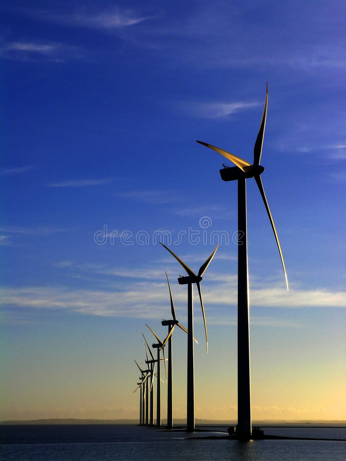 Wind turbines offshore royalty free stock photos