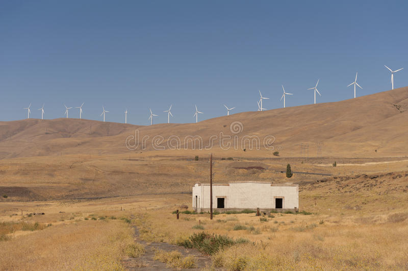 Wind Turbines and Old Building. Spanning 30 miles and offering a capacity of 500 megawatts, Windy Flats development is one of the largest wind energy projects in royalty free stock images