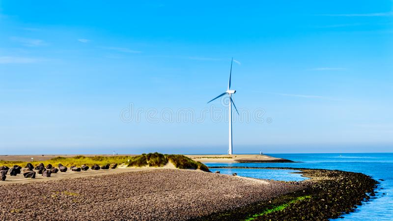 Wind Turbines at the Oosterschelde inlet at the Neeltje Jans island at the Delta Works Storm Surge Barrier. In Zeeand Province in the Netherlands stock photography