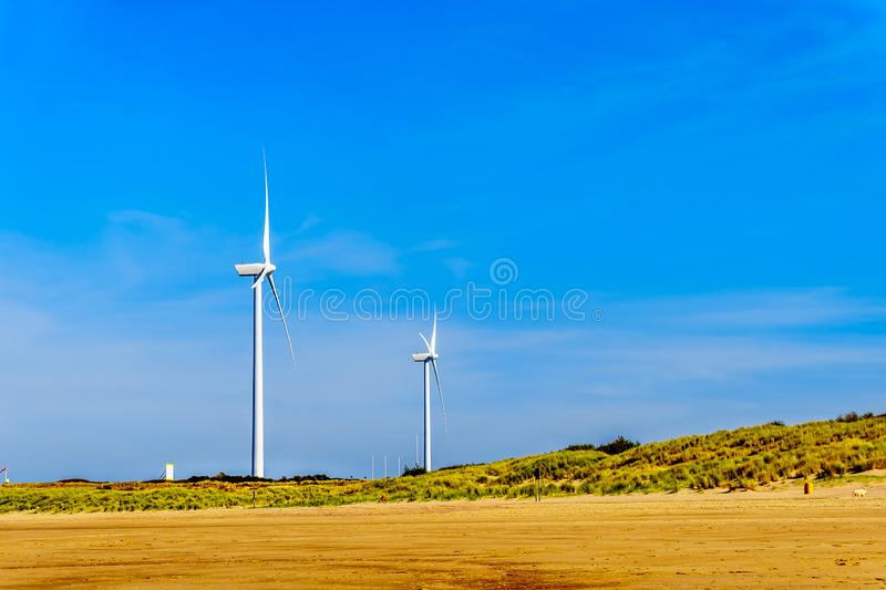 Wind Turbines at the Oosterschelde inlet at the Neeltje Jans island at the Delta Works Storm Surge Barrier in Zeeand Province stock photos