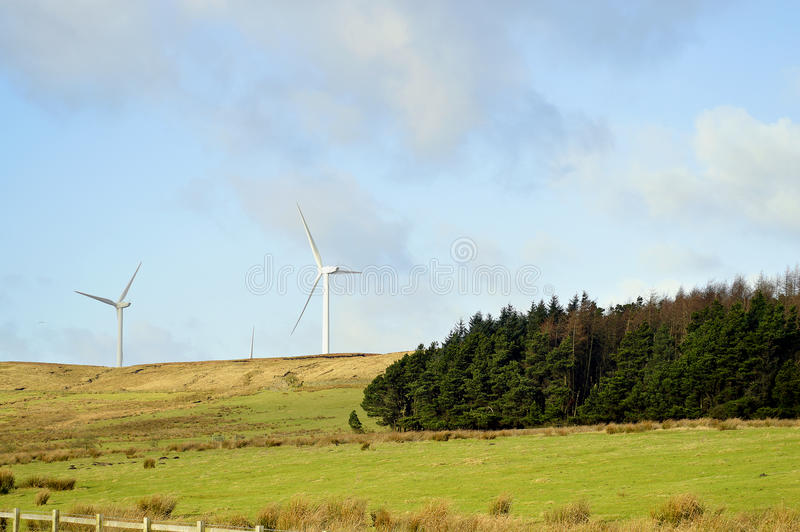 Wind turbines in Oswaldtwistle. Wind turbines on the hills of Oswaldtwistle in Blackburn stock images