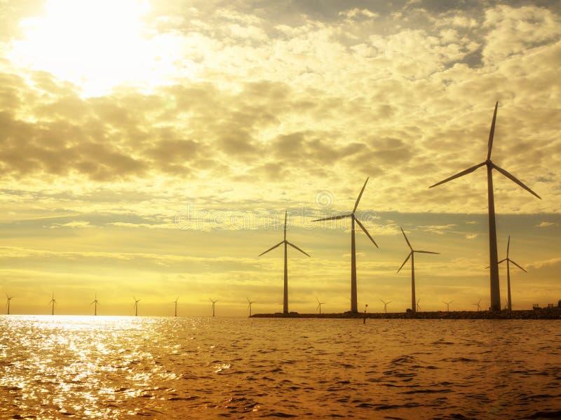 Wind turbines power generator farm in sea stock photo