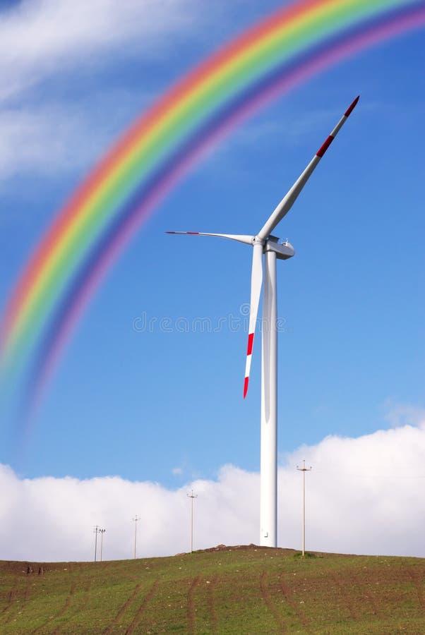 Wind turbines and rainbow stock image