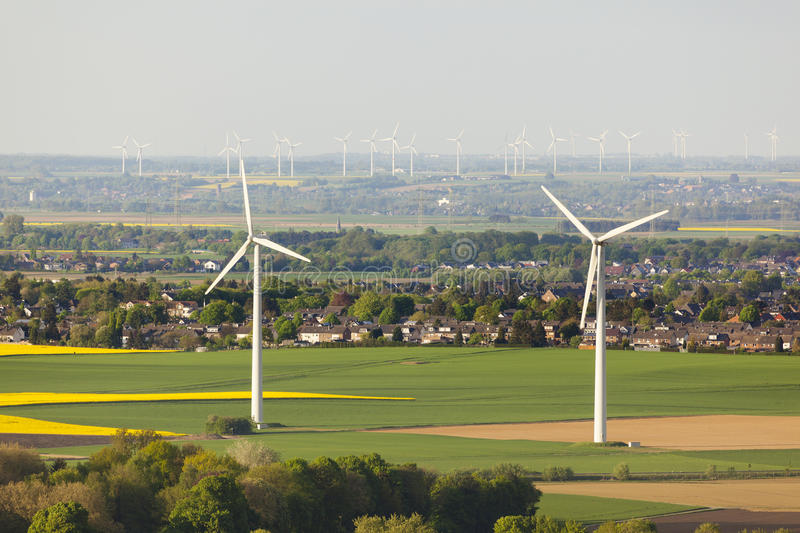 Wind Turbines And Fields. Flat west German landscape near Aachen and Herzogenrath with wind turbines and yellow fields royalty free stock photography