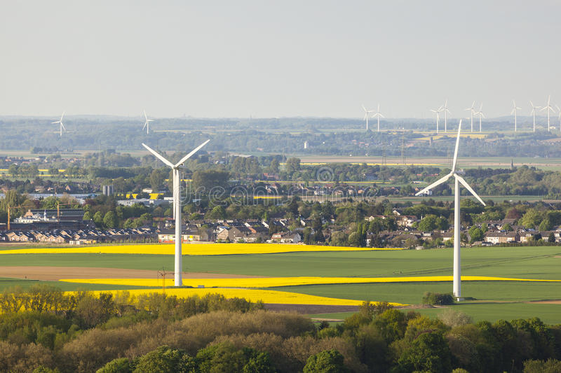 Wind Turbines And Fields. Flat west German landscape near Aachen and Herzogenrath with wind turbines and yellow fields stock image