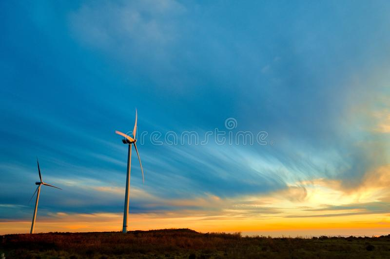 Wind turbines reflecting sunset light on Paul da Serra plain, Madeira island, Portugal royalty free stock images