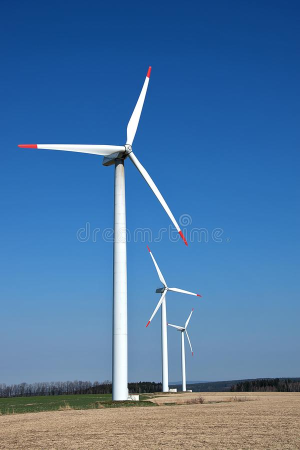 Wind turbines. Renewable energy with wind turbines. Windmills for electric power production stock photos