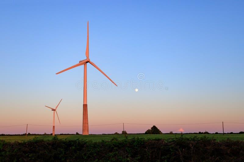Wind turbines on the road . Alternative energy stock images