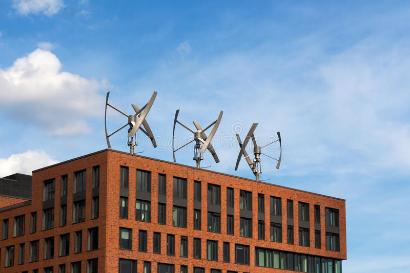 Wind turbines on the roof of a building stock images