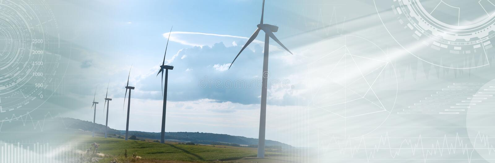 Wind turbines in a rural landscape; panoramic banner. Wind turbines in a rural landscape on sky background; panoramic banner royalty free stock photos