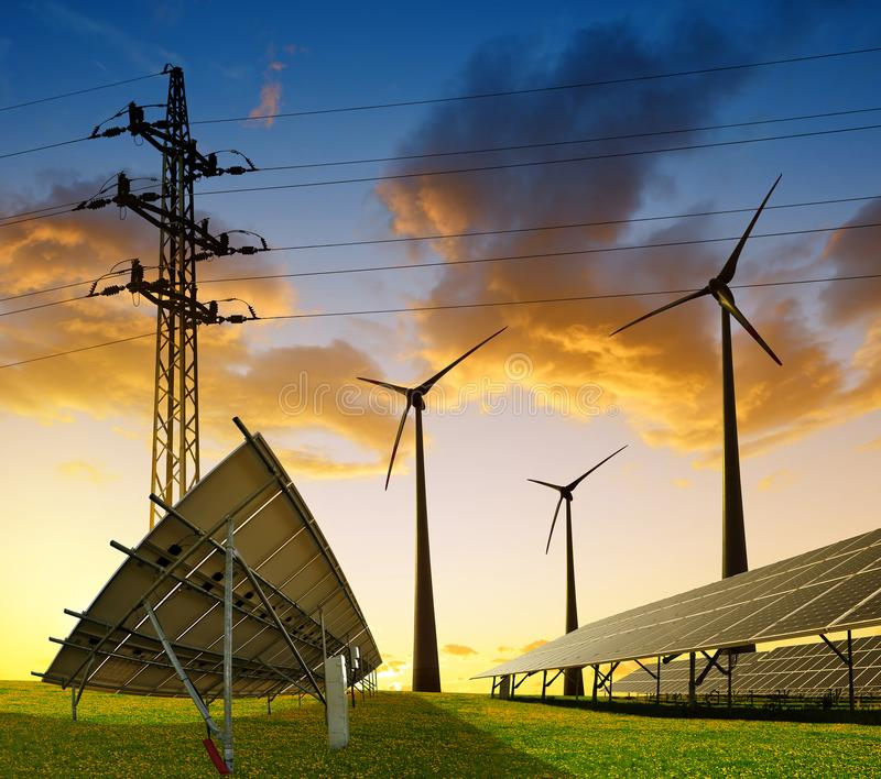 Wind turbines with solar energy panel and electricity transmission pylon. royalty free stock image