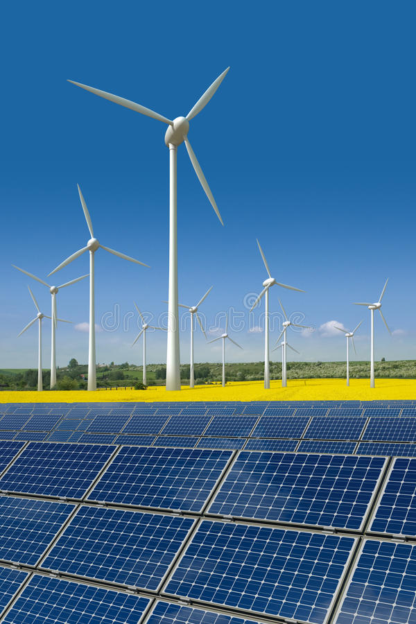 Download Wind Turbines And Solar Panels In A Rapeseed Field Stock Image - Image: 18982495