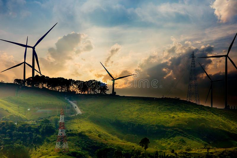 Wind turbines on sunny morning. Blade, blue, can, withstand, clean, day, dusk, ecology, electric, electricity, energy, environment-friendly, fog, curtain stock photo