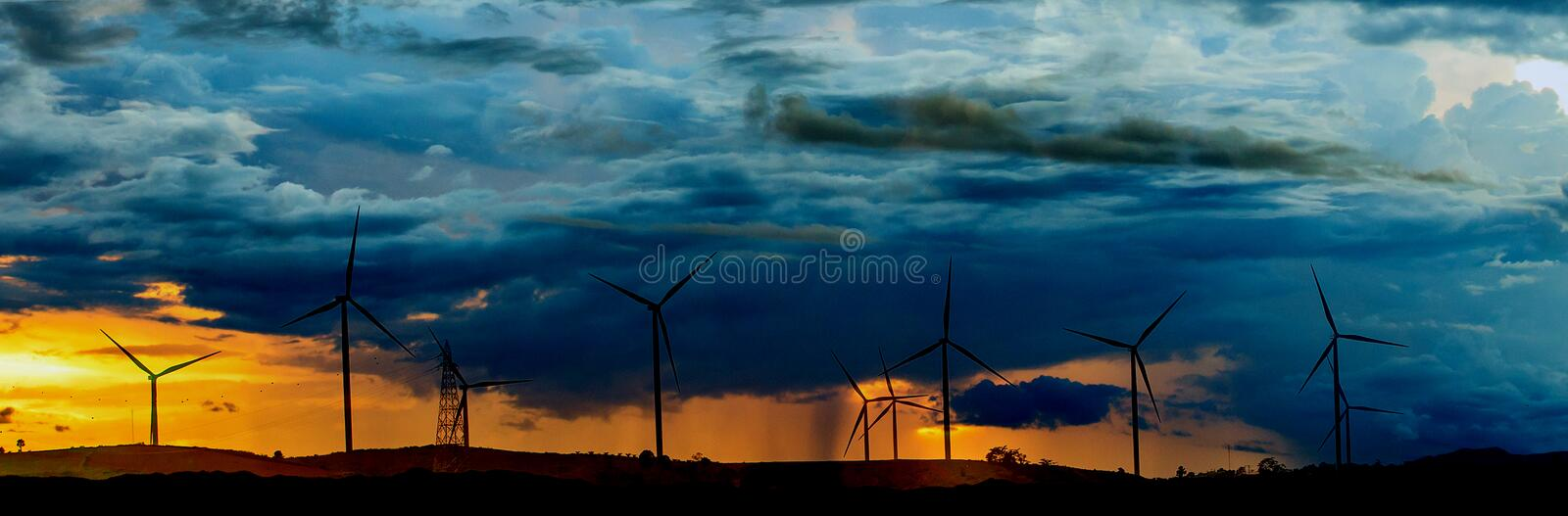 Wind turbines on sunny morning. Windmill, innate, electricity, life, form, natural, fog, curtain, green, magnification, clean, sustainability, breath royalty free stock photos