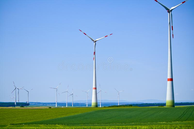 Wind turbines on sunny morning in Bavaria, Germany royalty free stock image