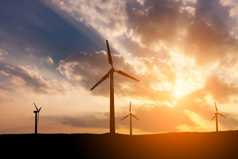 Wind turbines on the sunset sky background stock photo