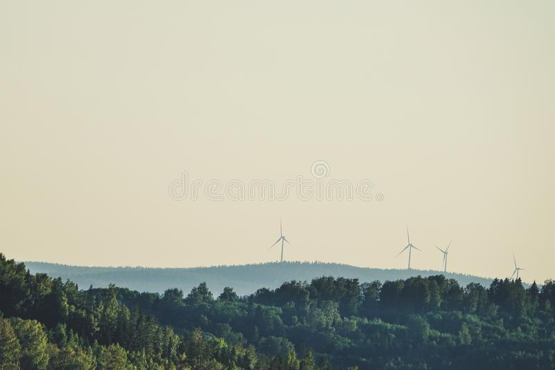 Wind turbines up on mountain. Renewable energy, power stock images