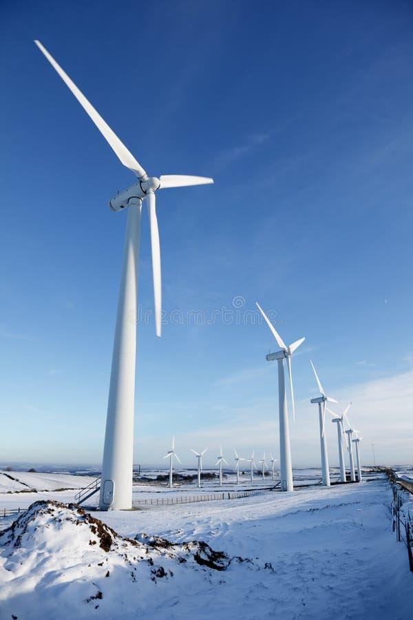 Wind turbines in winter stock photos
