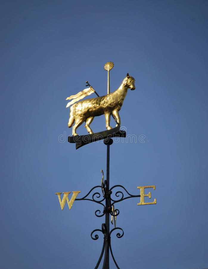 Wind vane. Photo of a wind vane against blue sky royalty free stock photo