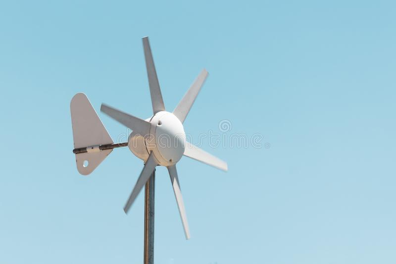 Wind vane and anemometer with rotating blades, wind power generation.  stock photo