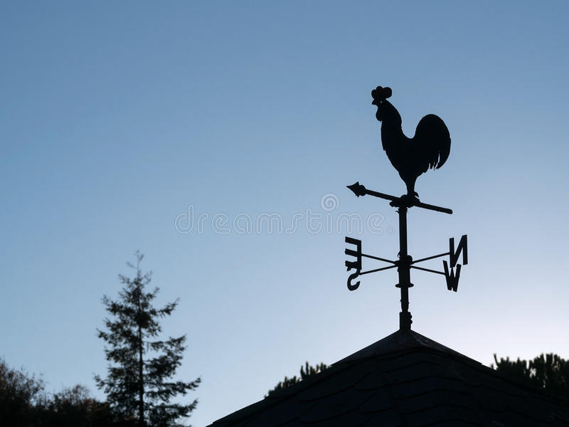 Wind vane silhouette stock photography