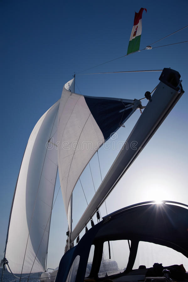 Wind in yacht sails. With beautiful cloudless sky in the background royalty free stock photos