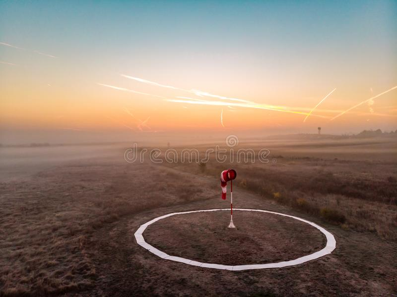 Windbag at foggy sunrise stock images