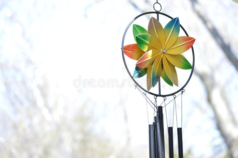 Windchime. Color wind chime against a bleak cloudy day royalty free stock images