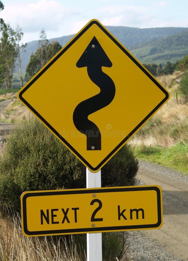 Windende verkeersteken stock foto