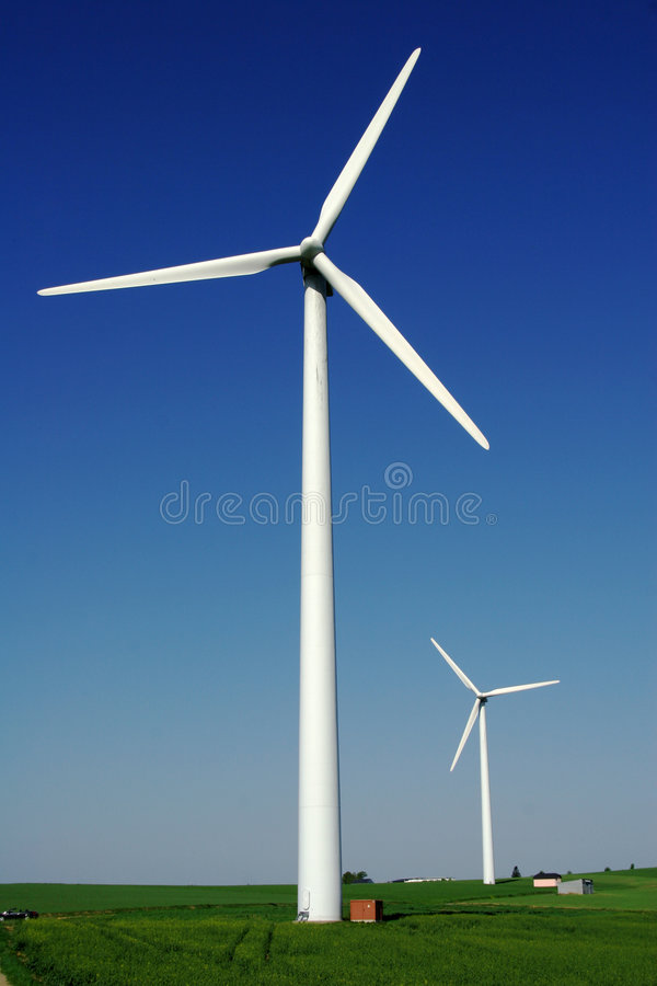 Windenergy 7. Two modern wind energy plants in rural area royalty free stock photo