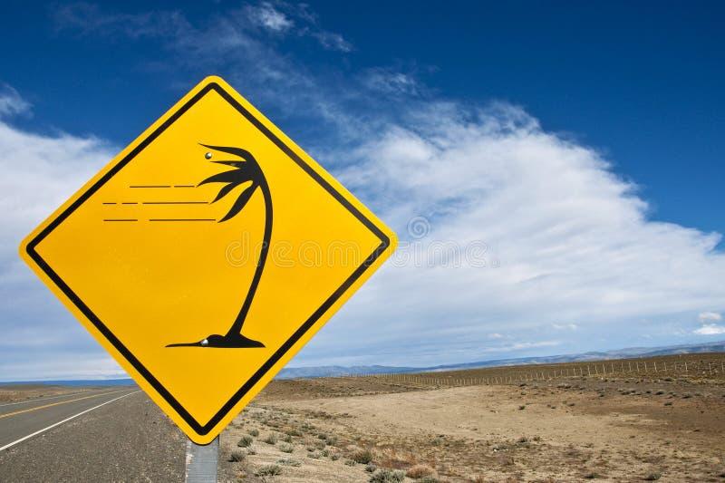 Winderige Verkeersteken in Patagonië stock foto's