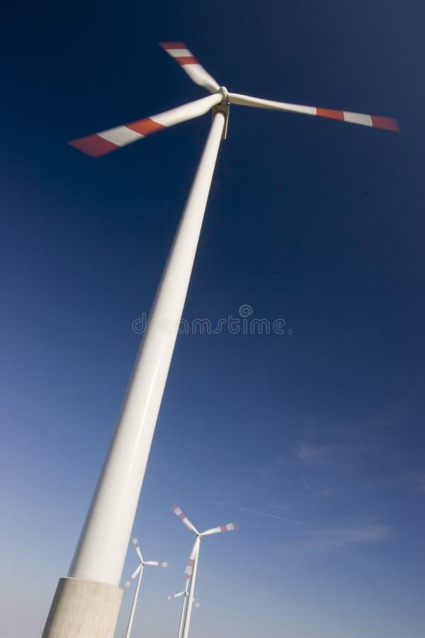 Windfarm against dark blue sky stock image
