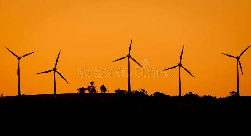 Windfarm At Sunset Royalty Free Stock Photos