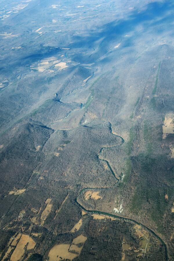 The winding channel of the river. Photo taken from an airplane window above USA royalty free stock photography