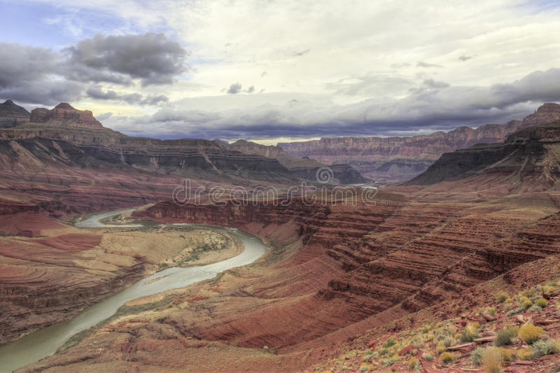 Winding Colorado River through Grand Canyon. The Colorado River winds its way through time in Grand Canyon National Park in Arizona royalty free stock photos