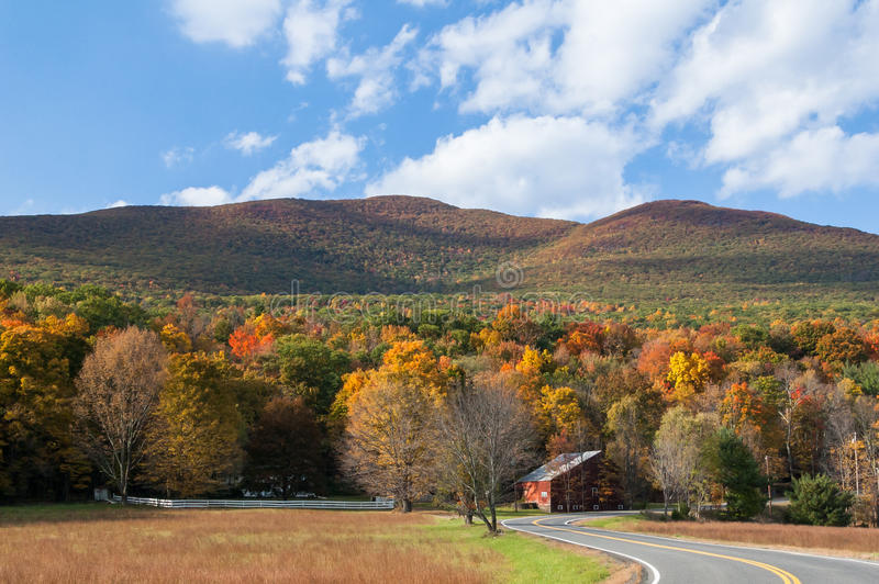 Winding country road through the Catskill mountains of New York. Fall foliage in upstate New York, Hudson Valley. Winding country road through the Catskill royalty free stock photography