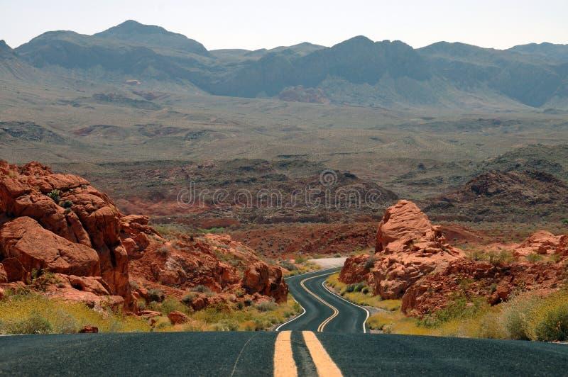 Winding desert mountain highway stock images