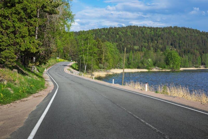 Winding highway along the lake stock photos