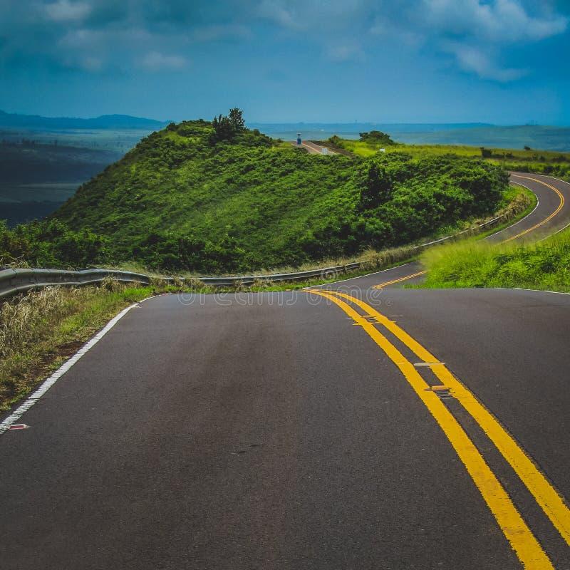 Winding Kauai Road. Curved road winding through the mountainous terrain of Waimea Canyon State Park, Kauai, Hawaii, United States royalty free stock photos
