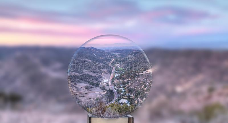 Winding Laguna Canyon road at sunset through a crystal ball as it cuts through the mountains in Laguna Beach. California royalty free stock images