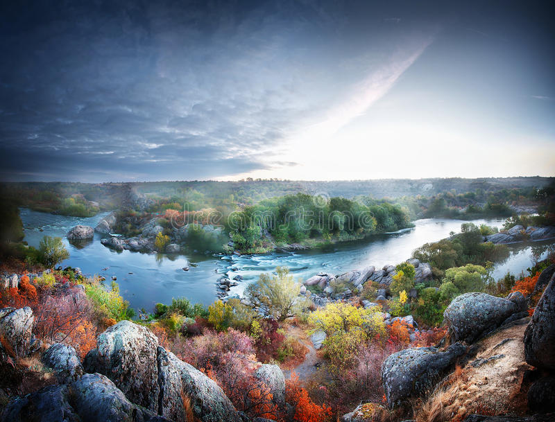 Winding mountain river. Flowing in a rocky forest valley stock images