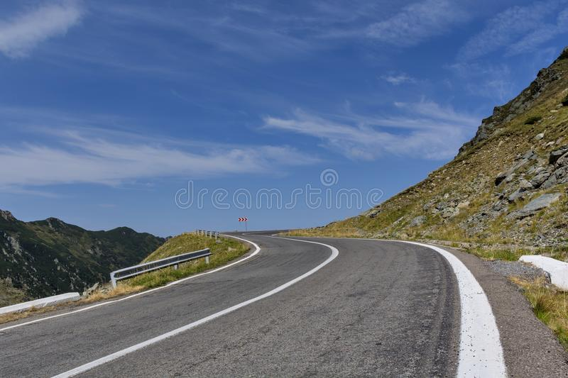 Winding mountain road with dangerous curves in Carpathian mountains. Transfagarasan road in Romania. Romania - Fagaras Mountains in Transilvania. Famous royalty free stock photos
