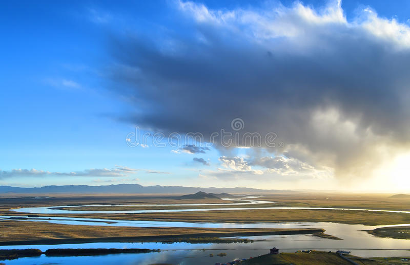 The winding river. In the sunset royalty free stock photography