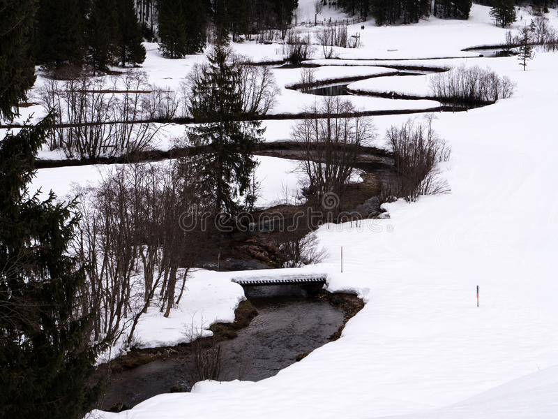 A winding river in a white winter landscape royalty free stock photography