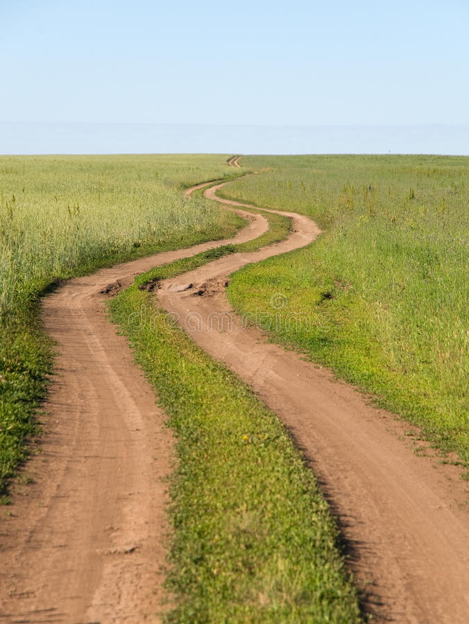Download Winding road stock photo. Image of green, clay, road - 14839586